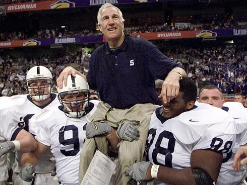 Jerry Sandusky being carried off the field by Penn State players